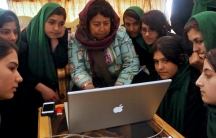 Razia Jan shares photos and stories with the 9th Grade class.