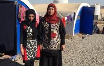 Zikra Younis, right, and her daughter Huda at the Khazer camp for displaced people. The camp is east of the Iraqi city of Mosul, where they escaped from last November.