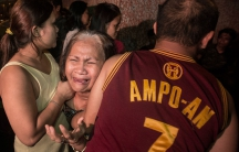 Yolanda Ampoan is hugged by her children after learning of the death of her son Sandrex Ampo. Ampo was killed by unknown assailant on September 23, 2016 in Punta Sta Ana, Manila.
