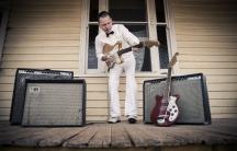 C.W. Stoneking playing his electric guitar