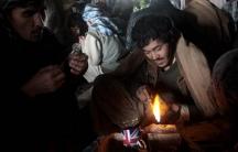 Three addicts preparing to smoke heroin under a bridge in Kabul's Pol-e Sokhta neighborhood.