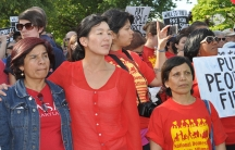 Ai-jen Poo, Director of the National Domestic Workers Alliance, stands with National Peoples Action to demand accountability for the financial crisis on May 20, 2012, Washington, DC.