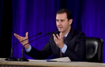 Syrian President Bashar al-Assad speaks during a meeting of the Central Bar Association in Damascus, Syria, Feb. 15, 2016.