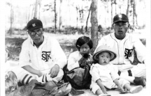 No Kum Sok, age 3, wearsing a pith helmet, with his father, No Zae Hiub (right), an all-star pitcher for his company's baseball team, in Sinhung, Korea, in 1935.
