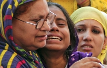 Relatives of Mohammad Akhlaq mourn after he was killed by a mob over rumors that he butchered a cow.