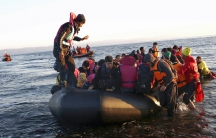Afghan migrants arriving by boat on the Greek island of Lesbos. Under the new plan, all such migrants would be automatically deported to Turkey.