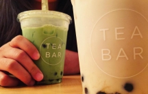 Two boba milk teas, close up