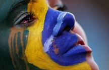 A Brazil fan cries as she watches the 2014 World Cup semi-final between Brazil and Germany at a fan area in Brasilia. Germany scored five goals in 18 astonishing first-half minutes on their way to a 7-1 semi-final mauling of Brazil on Tuesday.