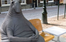 "Dutch artist Margriet van Breevoort  created the gray tubby creature, ""Homunculus Loxodontusa""  nicknamed ""the one who waits."""