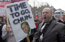Demonstrators hold placards during a protest in London on April 9, 2016. British Prime Minister David Cameron said on Saturday he should have handled scrutiny of his family's tax arrangements better and promised to learn the lessons after days of negative