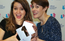 Children's doctor Katie Rogerson (left) and children's physiotherapist Caroline Smith of the NHS choir with the Official Christmas No 1 award for charity single A Bridge Over You, beating  out Justin Bieber.