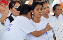 A woman cries during a meeting between FARC guerrilla leaders and victims of the La Chinita massacre