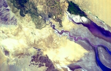 Colorado River Delta taken by the Spaceborne Thermal Emission and Reflection Radiometer (ASTER), flying aboard the Terra spacecraft, irrigation and urban sprawl now prevent the river from reaching its final destination.