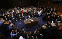 Former FBI Director James Comey prepares to testify before a Senate Intelligence Committee