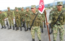 Young Colombian army troops in the southern town of Uribe, which used to be a FARC stronghold. Some are draftees serving their obligatory 18 months service; others are professional soldiers. Most come from humble backgrounds.