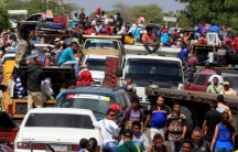 Venezuelans line up to cross into Colombia at the border in Paraguachón, Colombia, Feb. 16, 2018.