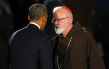 President Barack Obama talks to Cardinal Sean O'Malley during an interfaith memorial service for Boston Marathon bombing victims at Boston's Cathedral of the Holy Cross on April 18, 2013.