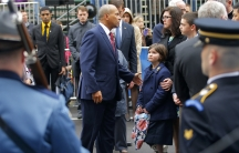 Massachusetts Governor Deval Patrick (C) joins the family of Boston Marathon bombing victim Martin Richard at the finish line for a wreath-laying ceremony in Boston, Massachusetts April 15, 2014. Richard's family members include sister Jane (3rd R), mothe