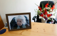 A photograph of Nancy Hatch Dupree, and a bouquet of flowers are seen in her office after she passed away, in Afghanistan Centre at Kabul University (ACKU), in Kabul, Afghanistan September 10, 2017.