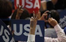 A delegate makes a victory sign.