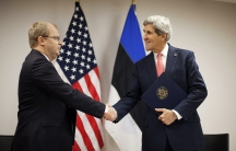 US Secretary of State John Kerry and Estonian Foreign Minister Urmas Paet sign the US Estonia Partnership Statement at NATO headquarters in Brussels December 3, 2013. The statement affirms the commitment of both countries to continue working together to e