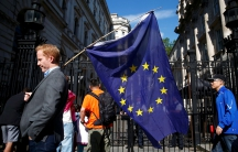 A man carries an EU flag after Britain voted to leave the European Union, outside Downing Street in London.