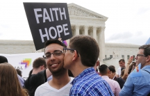Gay rights supporters celebrate outside the Supreme Court building in Washington on June 26, 2015. The court ruled 5-4 that the Constitution's guarantees of due process and equal protection under the law mean that states cannot ban same-sex marriages.