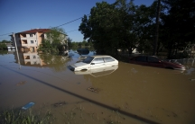 A car is seen stranded in the flooded town of Obrenovac, southwest of Belgrade.