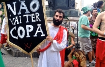 "An anti-World Cup ""Roman"" takes a breather after hours of singing and dancing at a Rio carnival party."