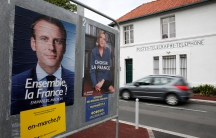 Official posters of the candidates for the 2017 French presidential election, Emmanuel Macron, left, head of the political movement En Marche!, or Onwards!, and Marine Le Pen, of French National Front (FN).