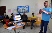 """Said Hassan, manager of Gaza Sky Geeks, advises entrepreneurs at the group's pre-investment """"boot camp."""""""