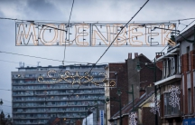 This Nov. 16, 2015 photo shows Christmas lights in the municipality of Sint-Jans-Molenbeek (also known as Molenbeek-Saint-Jean, or just Molenbeek) in Brussels. Multiple people were arrested there during weekend searches to find suspects in the Nov. 13 ter