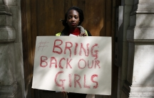 A protester outside the Nigerian Embassy in London holds a sign as she demonstrates against the kidnapping of school girls in Nigeria three weeks ago. There's been a world-wide outcry about the abductions carried about the Islamist militant group Boko Har