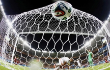 Clint Dempsey (C) of the U.S. knocks the ball into the net to score against Portugal during their 2014 World Cup Group G soccer match at the Amazonia arena in Manaus