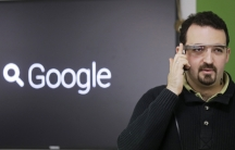 Developer Maximiliano Firtman wears a prototype Google Glass device in November 2013.