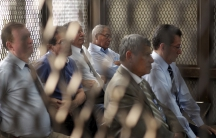 Retired military officers, from left, Luis Alberto Paredes, Byron Humberto Barrientos, Ismael Segura Abularach, Benedicto Lucas, Gustavo Alonzo Rosales and Carlos Augusto Garavito sit in a cage