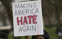 "A protestor carries a sign that reads ""Making America Hate Again."""