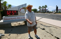 Palm Springs resident Benito Almojuela takes a selfie near a thermometer sign which reads 125 degrees in Palm Springs, California, June 20, 2016.