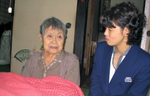 Social worker Minori Nakaso pays a home visit to an atomic bomb survivor in Hiroshima.