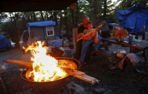 Matt Hannahs, 32, poses with his son Devin outside their tent