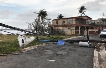 Sneakers hang from downed wires in the wake of Hurricane Maria