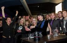 Birgitta Jonsdottir of the Pirate Party reacts alongisde party members
