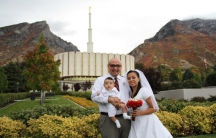 Laura López with her husband and first child on her wedding day.