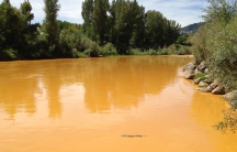 The Animas River, mustard-color about 24 hours after a spill.