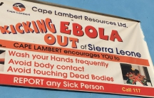 One of many banners around Freetown, Sierra Leone, warning people not to touch one another because of Ebola.