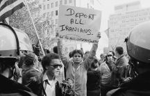 A man holding a sign during a protest of the crisis in Washington, D.C., in 1979.