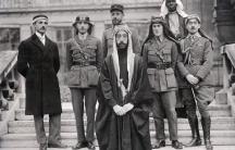 Left to right: Rustum Haidar, Nuri as-Said, Prince Faisal (front), Captain Pisani (rear), T. E. Lawrence, Faisal's slave (name unknown), Captain Hassan Khadri.