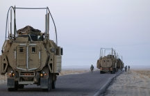 Soldiers with the 3rd Brigade Combat Team, 1st Cavalry Division perform a security check on their Mine Resistant Ambush Protected (MRAP) vehicles near the Kuwaiti border as part of the last U.S. military convoy to leave Iraq December 18, 2011. The last co