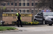 An Overland Park, Kansas, police officer guards the entrance to the scene of a shooting at the Jewish Community Center of Greater Kansas City in Overland Park, Kansas April 13, 2014. Three people were killed in shootings at Jewish centers in Kansas on Sun