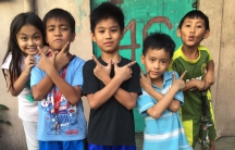 Kids posing for a photo in the Eastern Samar province of the Philippines